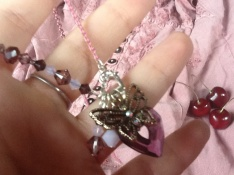 After attaching your chams, connect your desired crystal insert strand to the same clasp you used to attach your charm layers.