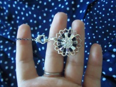 "A necklace is started with the filigree compass charm/pendant and a navy blue 10"" enameled brass base strand."