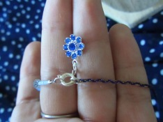 The loose ends are closed with a Swarovski crystal flower drop hook up clasp.