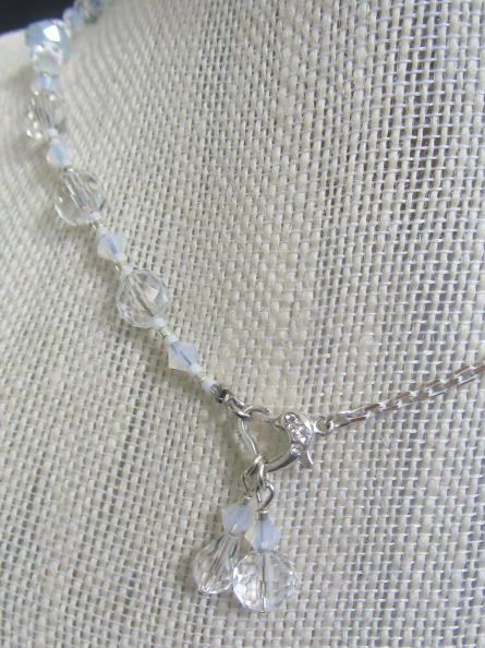 The bold asymmetrical necklace uses the same chain base strand seen in the anklet image.