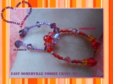 Interlocking bracelet created to echo the colors in the East Somerville Foodie Crawl banner. This quick and easy design features glamour and emberglow crystal strands (connected with 3 hook-up clasps in the back).