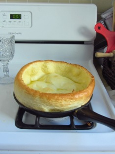 Roger's recipe for Dutch baby pancakes: While skillet is preheating, combine 2 eggs, 1/2 cup milk, 1/2 cup sifted flour, lemon zest, a pinch of salt and 1 tsp vanilla extract. Remove preheated skillet from oven, and turn down heat to 425 degrees F. Melt 2 tablespoons of butter onto the skillet, and then puour your pancake batter into skillet. Remove when golden brown, as pictured.