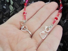 Attach another heart tab hook up clasp to the other end.