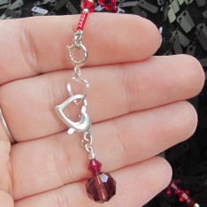 Connect a crystal beaded heart hook up clasp (pomegranate) to one heart at a time to complete your bracelet.
