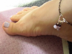 To wear the base strand as an anklet, simply use the connect technique to attach strand in a circle around anklet. You can attach charms before putting the anklet on.
