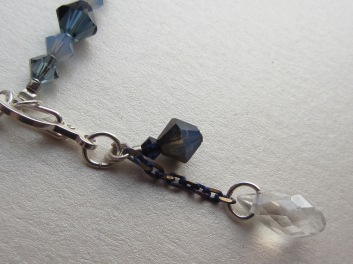 "A custon ""moonbeam"" hook-up clasp is included in the set, as another personal touch."