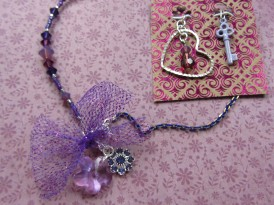 The mysterious nightshade plant, or bella donna, is a symbol of feminine beauty and mystery. To echo this idea, I included two flower charms (Swarovski crystal flower pendant in lilac; Swarovski crystal flower drop in tanzanite). Because her mother gave it to her as a gift, I wanted to include a heart to remind Emily of the love she shares with her family. The last charm is a custom purple key, to help Emily unlock her inner dreams and share them with the world as she grows.