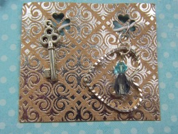 This set includes custom charms. The first charm - not in this image is a hand-embrodered crystal star. The second is our signature skeleton key to symbolize opening doors, expanding horizons. The third is a silver heart with crystal droplet in lagoon blue to symbolize the connections of love and friendship.