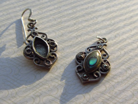 This pair of earrings is one of my favorites - but after one of the charms lost its mother-of-pearl inlay, the set became unwearable.